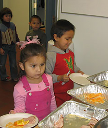 Children being feed in school
