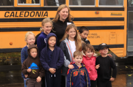 Children in front of a school bus