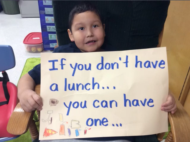 Child Holding Sign 6