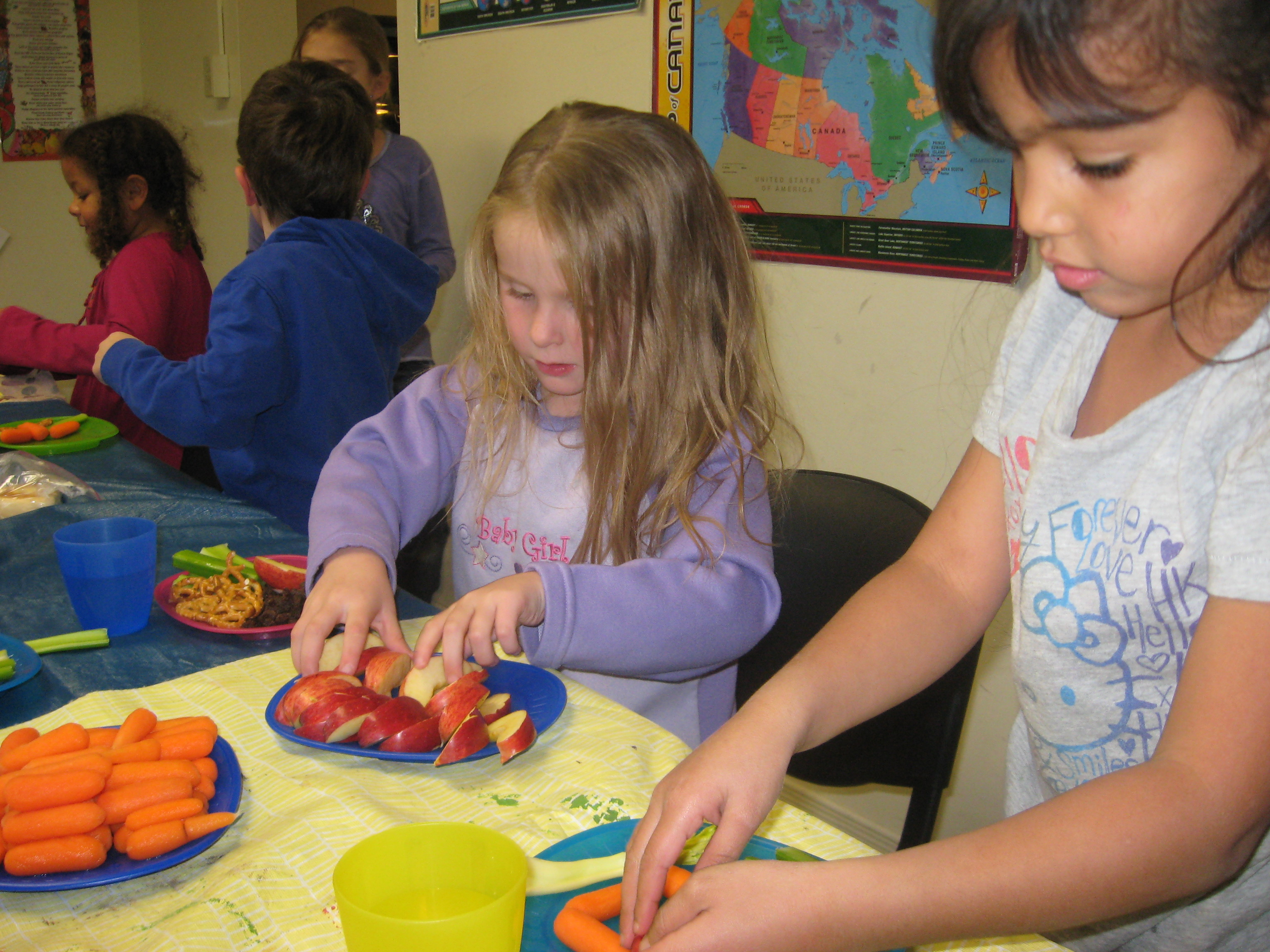 Children preparing plates of food