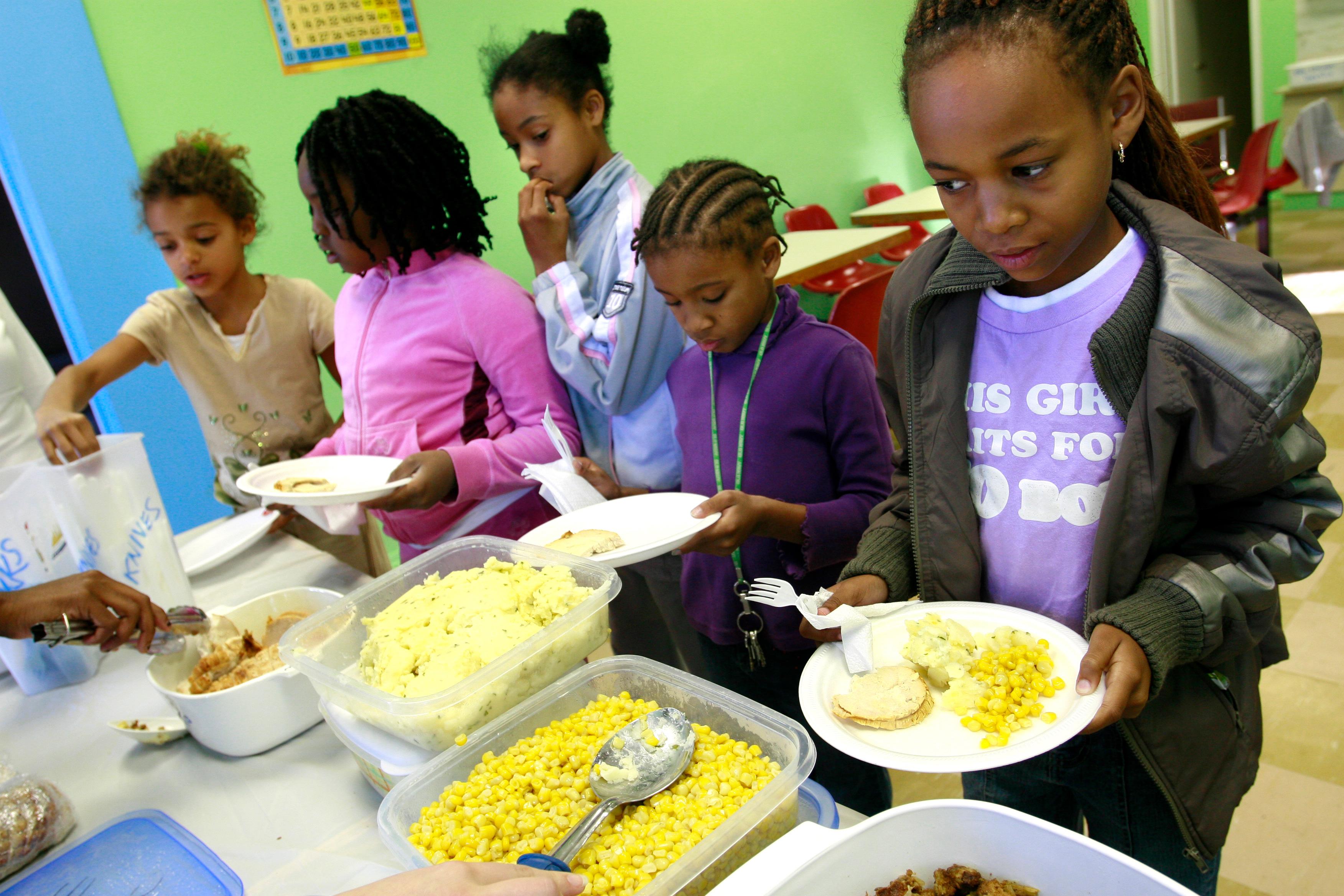 Group of children receiving meals